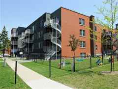 Les Maisons traditionnelles: affordable housing for young mothers at Benny Farm.