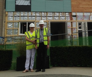 Jacqueline and Robert in front of not quite finished houses