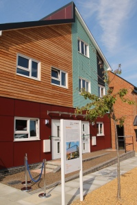 Front view of finished ÜserHuus/Tigh Grian at BRE, Watford